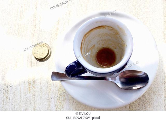 Empty espresso cup on cafe table