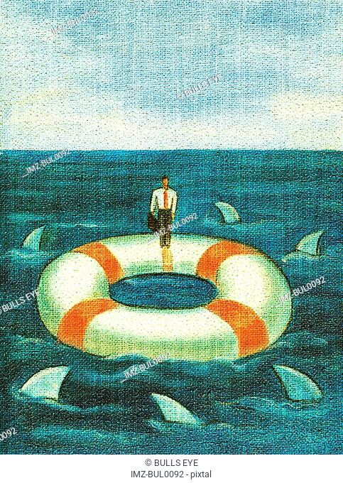 A businessman standing on a lifesaver that is surrounded by sharks