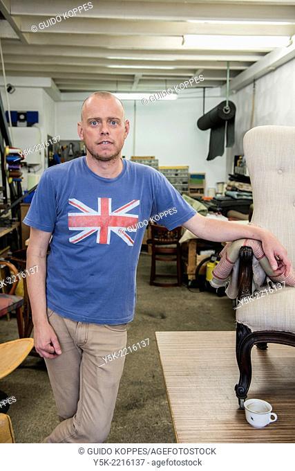 Tilburg, Netherlands. Werner assistes his male partner Josef, who works as an independent upholsterer in his own workshop, down town Tilburg