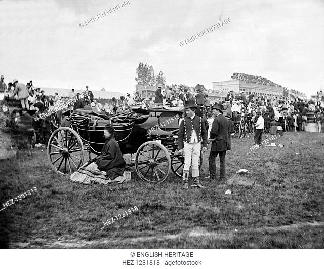 Ascot Racecourse, Berkshire, c1870-c1900. A crowds of racegoers watch the sport at Ascot Racecourse. The grandstand can be seen in the distance