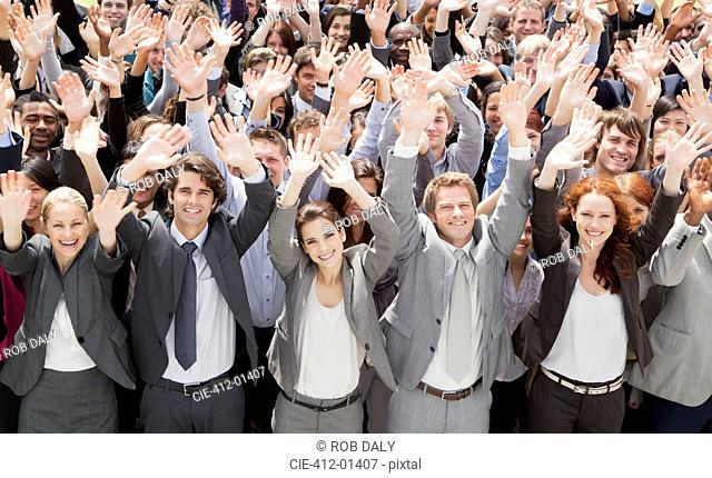Portrait of cheering business people in crowd