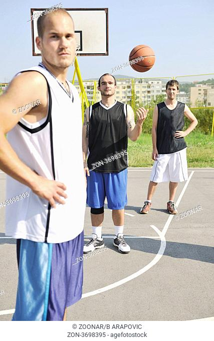 basketball player team group posing on streetbal court at the city on early morning