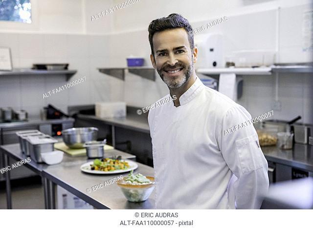 Chef in commercial kitchen, portrait