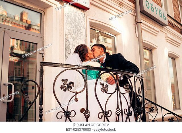 Morning wedding kiss in Prague