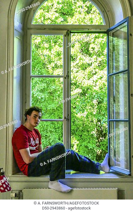 STOCKHOLM, SWEDEN 16 year old teenager sits in window