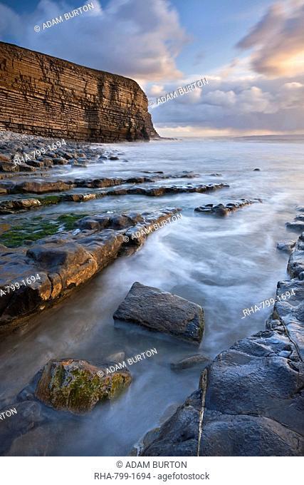 Rocky shore of Nash Point at sunset, Glamorgan Heritage Coast, Wales, United Kingdom, Europe
