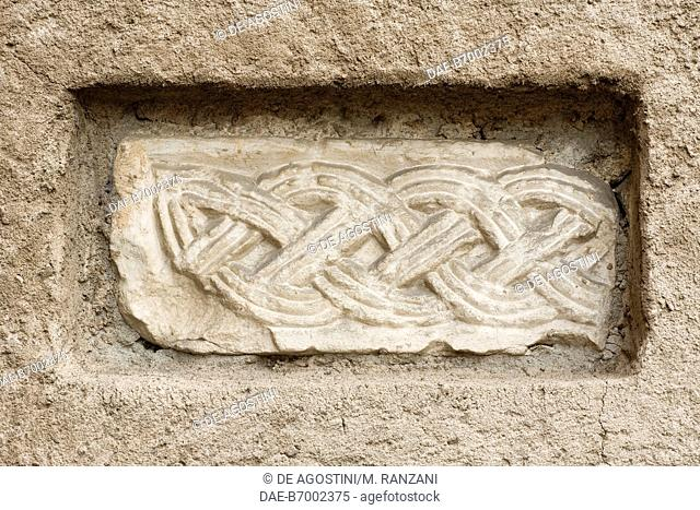 Fragment of interlaced ribbon frieze, 8th century, apse of the Collegiate church of St Stephen, Vimercate, Lombardy, Italy, 11th-12th century