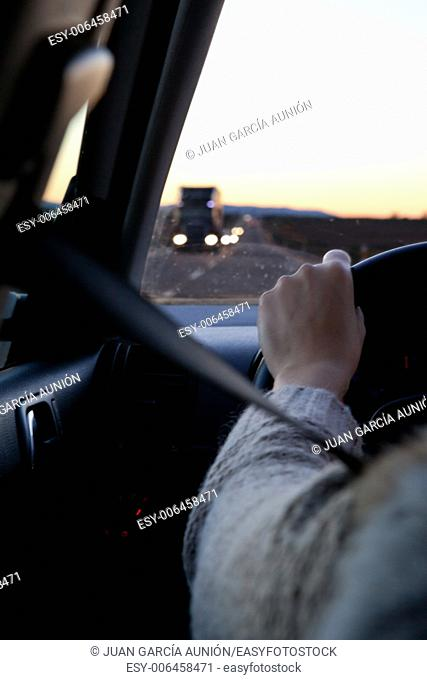 Driver sitting in the car with safety-belt on