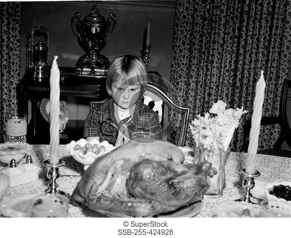 Girl praying before Thanksgiving meal