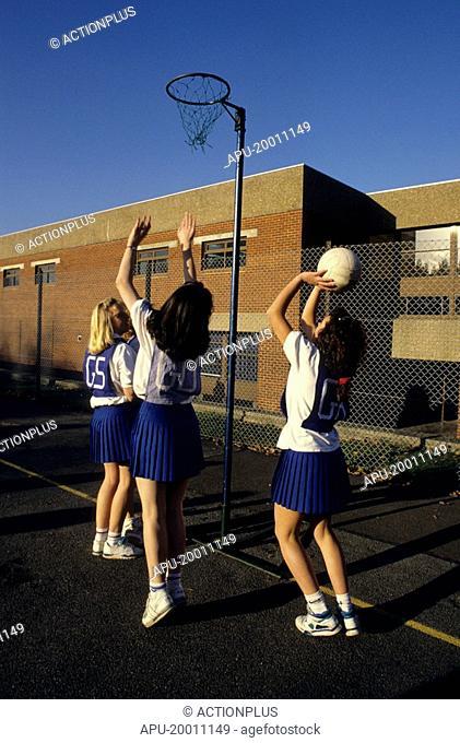 Girls playing netball at school