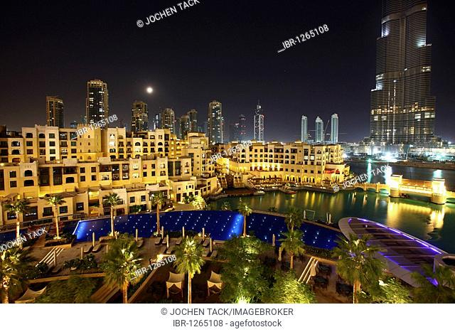 Burj Dubai, tallest building in the world, and pool area of the luxury hotel The Address, part of Downtown Dubai, United Arab Emirates, Middle East