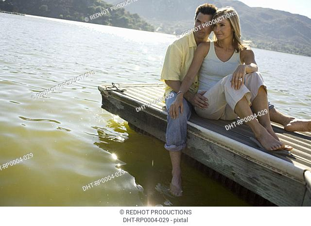 Young couple by lake