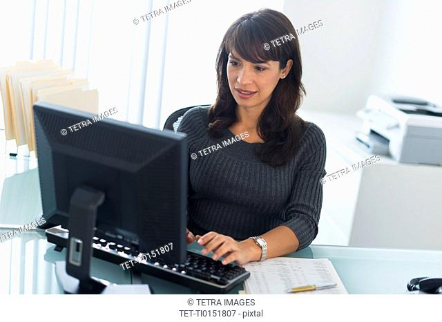 Business woman using computer