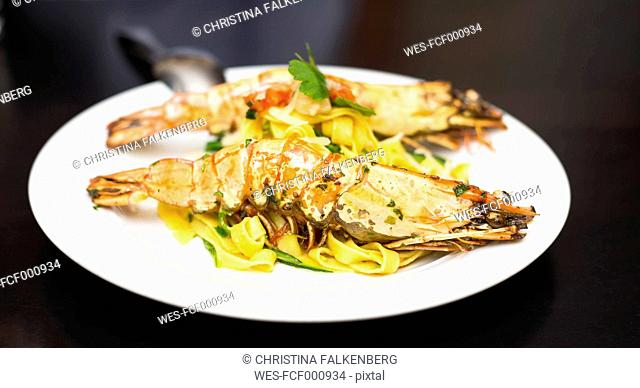 Spiny lobster on fresh pasta on plate