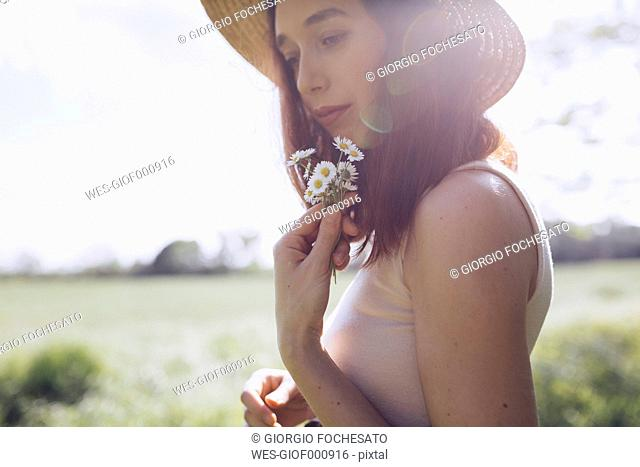 Young woman with daisies