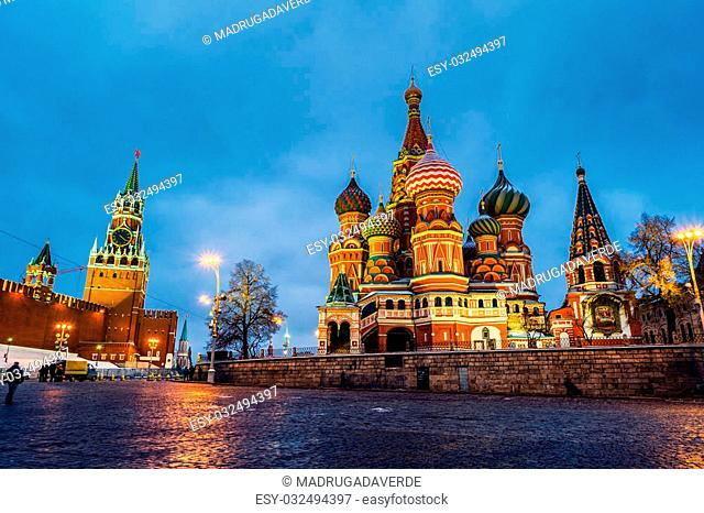 Saint Basil Cathedral on Red Square at night with Kremlin wall and Tower. One of the most popular landmark in Russia. The building is shaped as a flame of a...