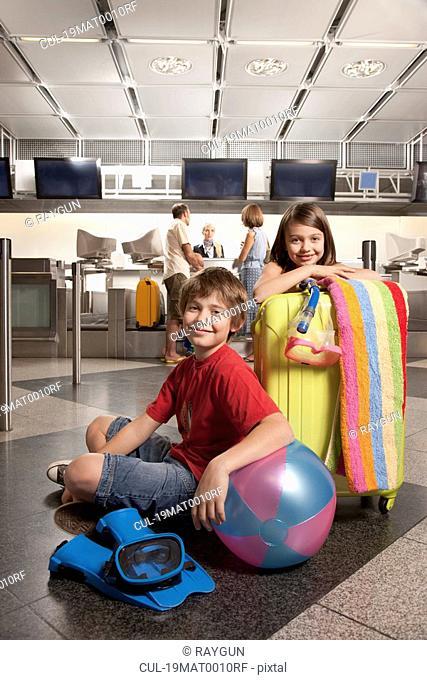 Children waiting at airport checkin