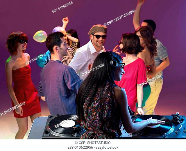 girl mixing music at party