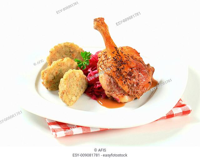 Roast duck with Tyrolean dumplings and red cabbage