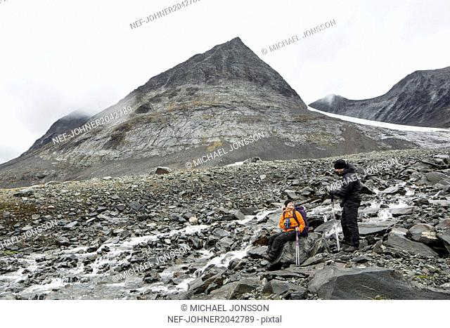 Hikers resting in mountains