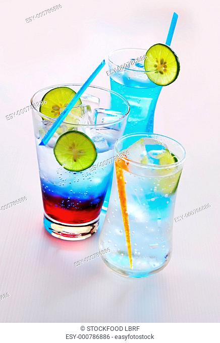 Three soda water drinks with lime