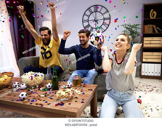 Excited fans celebrating at football party
