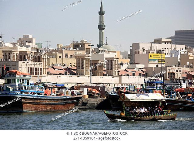 Abra shuttle boat, Deira skyline, Dubai Creek, Dubai, United Arab Emirates