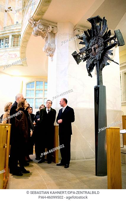 Queen Silvia of Sweden (L) stands next to the old tower cross in the Church of Our Lady in Dresden, Germany, 07 February 2014