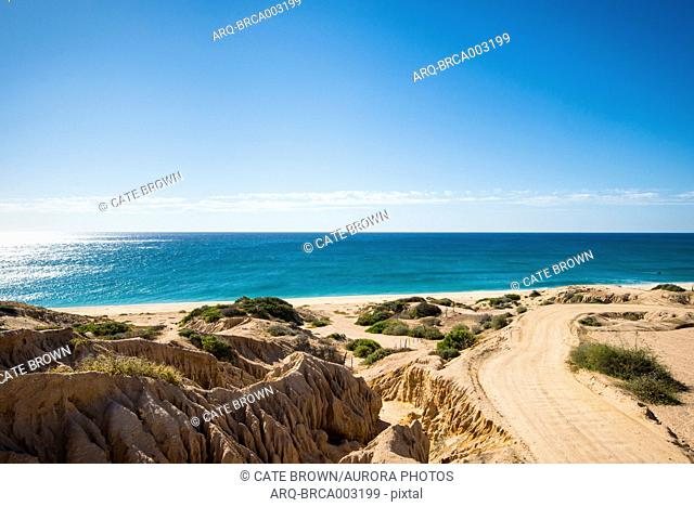 View of road on beach and horizon over sea, Cabo Pulmo, Baja California Sur, Mexico