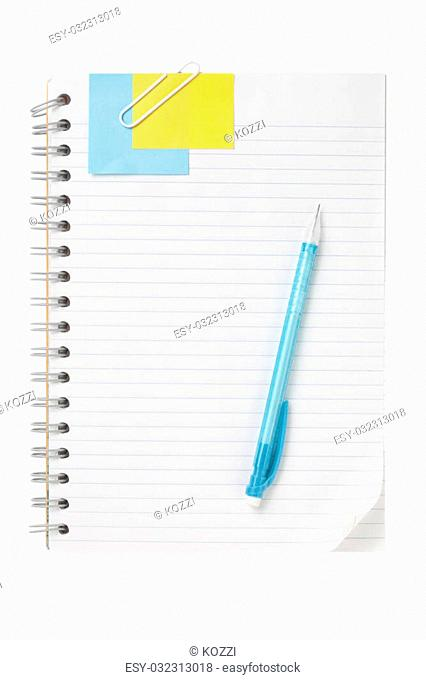 Close up image of open notebook with ball pen and note against white background