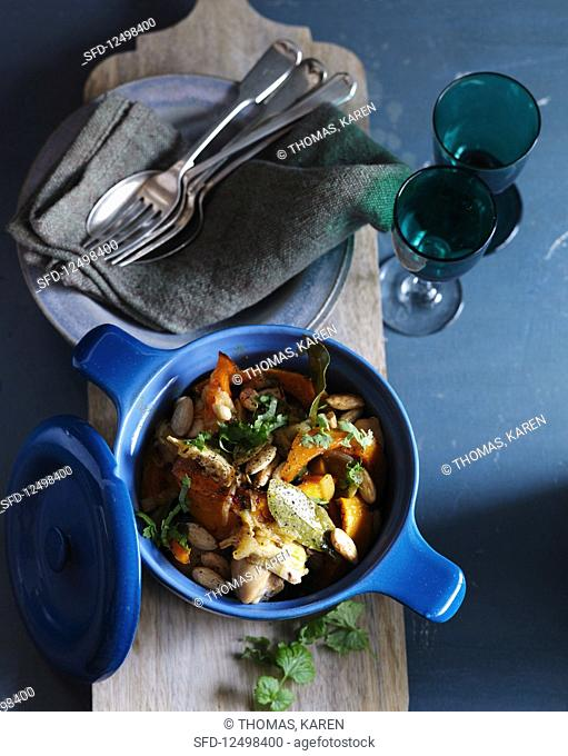 Chicken tagine with carrots, pumpkin and almonds