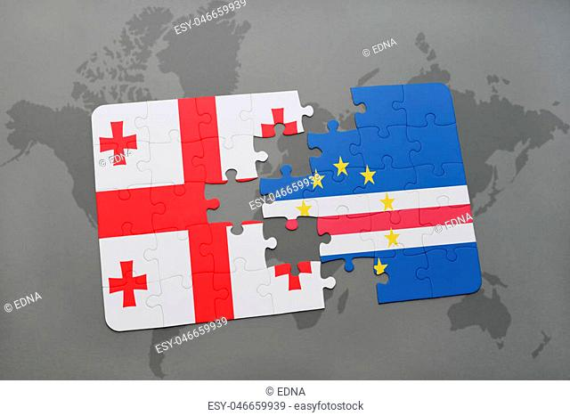 puzzle with the national flag of georgia and cape verde on a world map background. 3D illustration