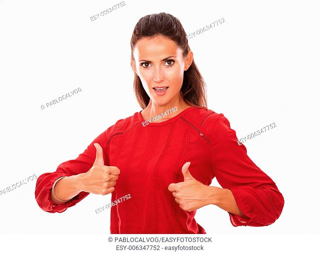 Portrait of sexy young woman on red shirt with good job fingers looking at you on isolated studio