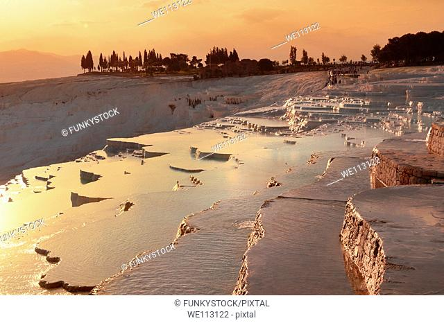 Pamukkale Travetine Terrace, Turkey, at sunset Images of the white Calcium carbonate rock formations