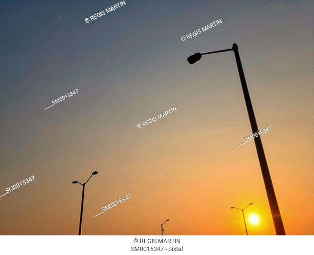 Sunrise and lampost silhouettes