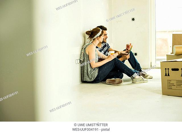 Couple moving house looking at colour samples