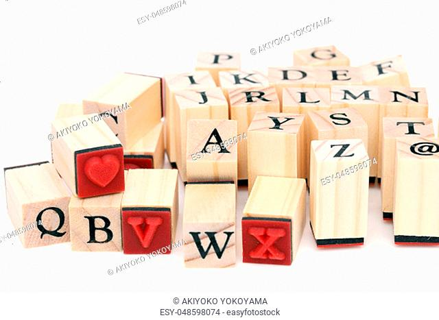 Close up of type set rubber stamps with wooden handle. the alphabet