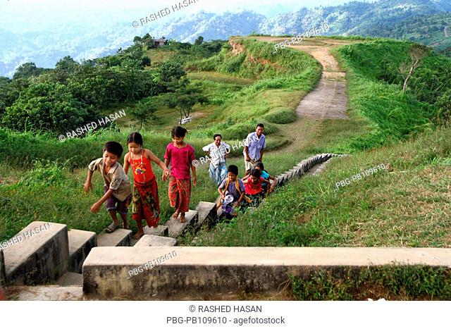 A group of ethnic people moving at the Nilgiri which is located 47 kilometers Southeast of Bandarban town on Chimbuk range