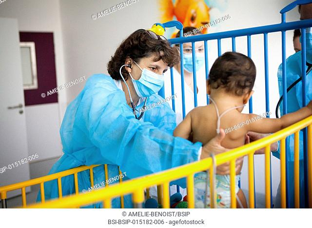 Reportage in the pediatric unit in a hospital in Haute-Savoie, France. A doctor examines a baby with breathing difficulties