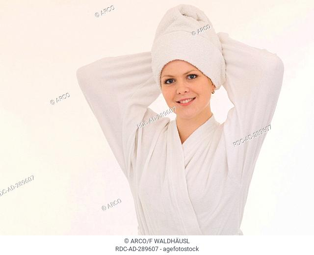 Young woman in a white bathrobe