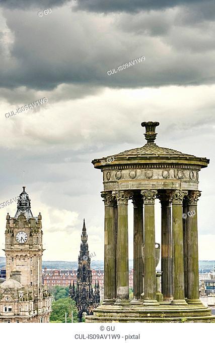 Elevated cityscape with Dugald Stewart monument and Scotts monument, Edinburgh, Scotland, UK
