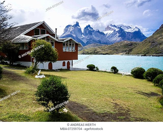Hosteria Pehoe at Lake Pehoe, Paine horns in the background, Torres de Paine National Park, Patagonia, Chile