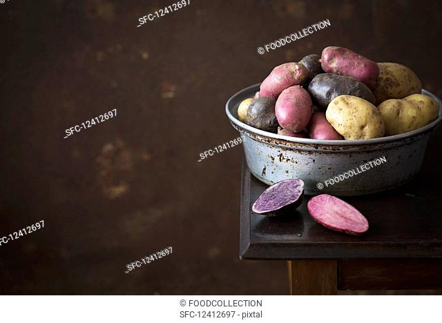Colorful potatoes in a metal bowl