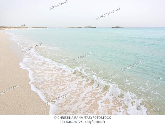 Dreamy soft paradise beach with crystal clear water on an overcast day in Formentera, Balearic islands, Spain