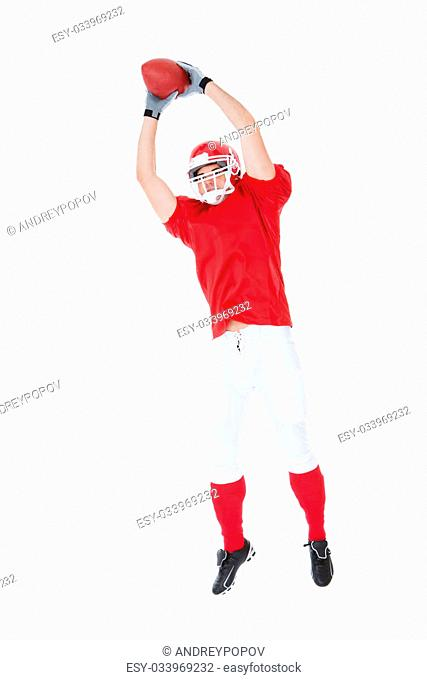 American Football Player Catching Ball On White Background