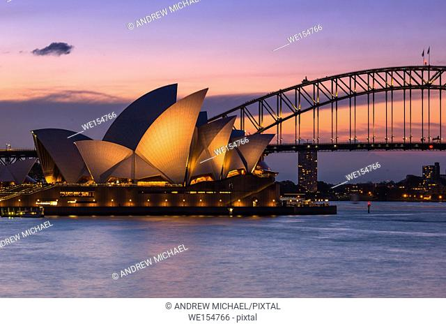 Sydney Opera House and Harbour bridge after sunset seen from Mrs Macquarie's Chair, Sydney, New South Wales, Australia