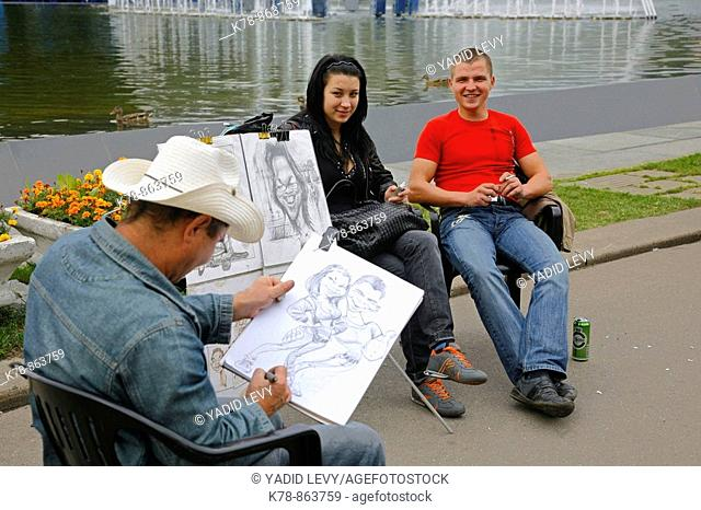 Sep 2008 - Young couple having their portrait at painted at Gorky Park, Moscow, Russia