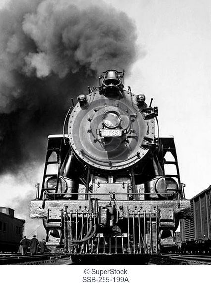 Low angle view of a steam engine exhausting smoke
