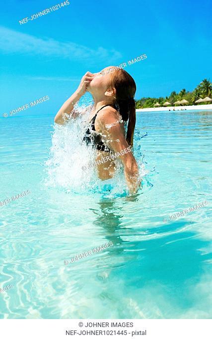 Girl splashing about in sea