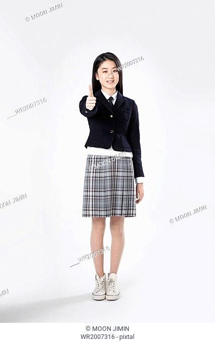 a girl in a school uniform giving thumbs up